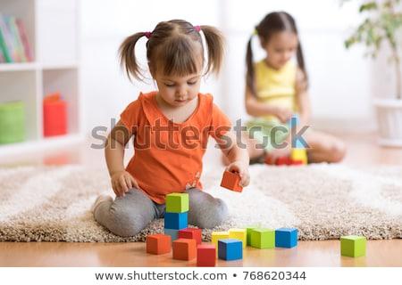 two children playing on floor Stock photo © gewoldi