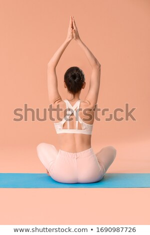 young woman sitting in lotus position meditating stock photo © candyboxphoto