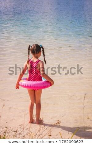 девочку морем надувной диска глазах воды Сток-фото © Mikko
