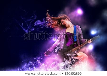 Estrela do rock menina guitarra guitarra elétrica ver de volta sensual Foto stock © stokkete