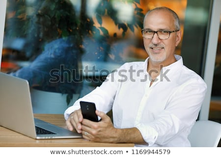 idős · üzletember · laptop · telefon · számítógép · internet - stock fotó © monkey_business