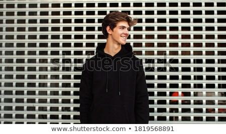 portrait of handsome young guy stock photo © acidgrey