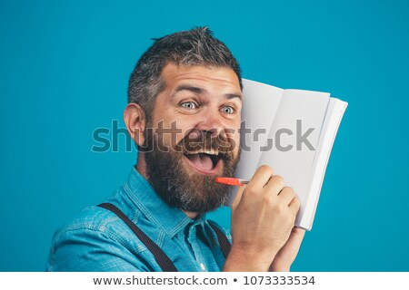 élégant affaires écrit journal blanche homme Photo stock © wavebreak_media