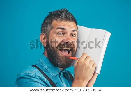 handsome businessman writing in his diary stock photo © wavebreak_media