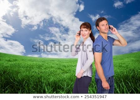 Paar beide telefoon mobiele telefoons man Stockfoto © wavebreak_media