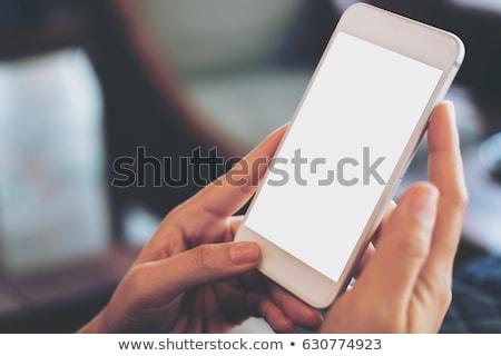persoon · handen · mobiele · telefoon · bureau - stockfoto © AndreyPopov