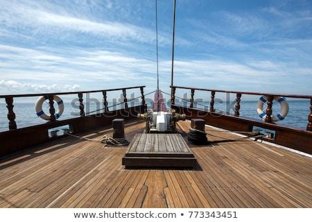 hajó · néz · ki · álomszerű · horizont · felhők - stock fotó © pixpack