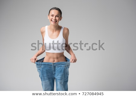 Slim and fit jeans beauty. stock photo © lithian