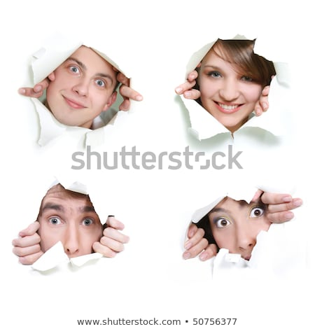 Stock photo: Two young men looking out in hole in paper