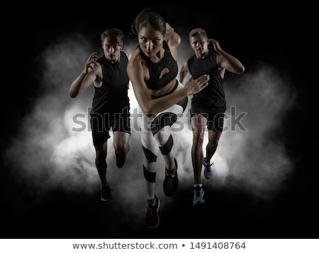 Muscular woman on a dark background Stock photo © Nobilior