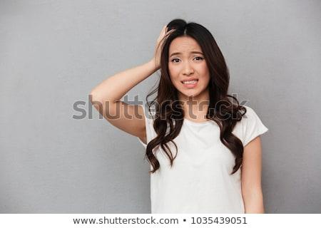 ストックフォト: 小さな · アジア · 女性 · 立って · 壁 · 画像