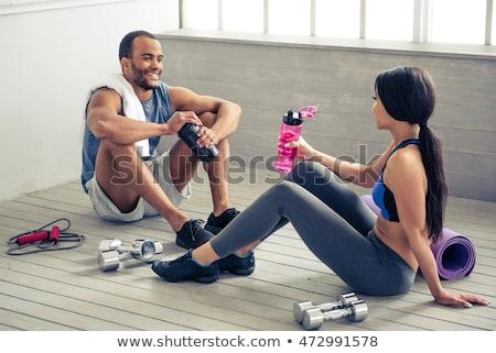 Erős sportok hölgy ül tornaterem ivóvíz Stock fotó © deandrobot