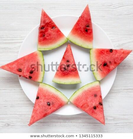 Szeletel lédús görögdinnye menta kilátás tányér Stock fotó © Lana_M