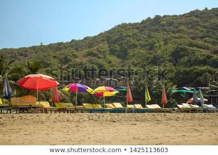 Multi colored wooden huts on sand against mountain Stock photo © wavebreak_media