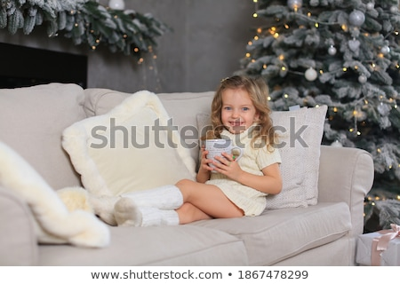Smiling girl with hand cupped against white background Stock photo © wavebreak_media