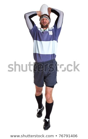 Full length of male rugby player throwing ball Stock photo © wavebreak_media