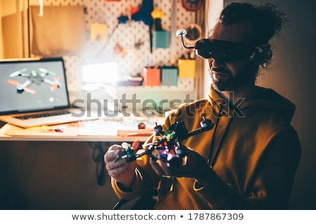 Man Repairing Quadrocopter Drone Stock photo © AndreyPopov
