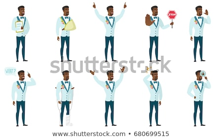 Groom standing with raised arms up. Stock photo © RAStudio