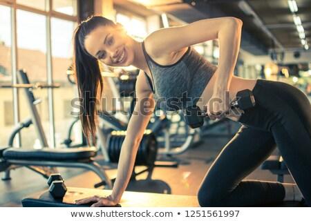 genç · kadın · kaslar · halter · spor · salonu · spor · uygunluk - stok fotoğraf © dolgachov