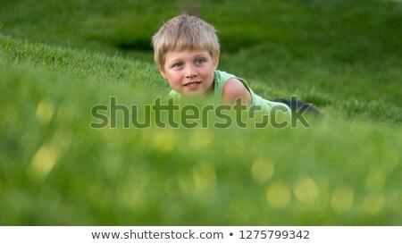 Stock fotó: Fiú · fű · domboldal · gyermek · portré · fiatal