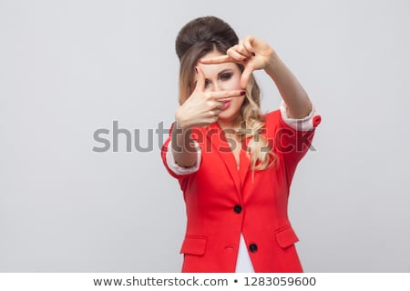 Photos belle femme rouge blazer permanent isolé Photo stock © Traimak