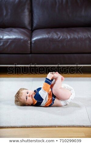 8 month old baby in diaper lying on rug Stock photo © IS2