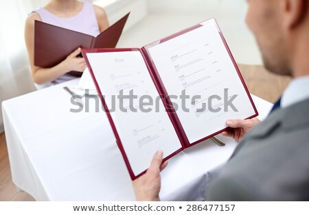 young couple reading menu close up stock photo © is2