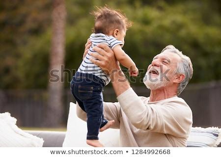 abuelo · nieto · playa · cielo · agua · sonrisa - foto stock © is2