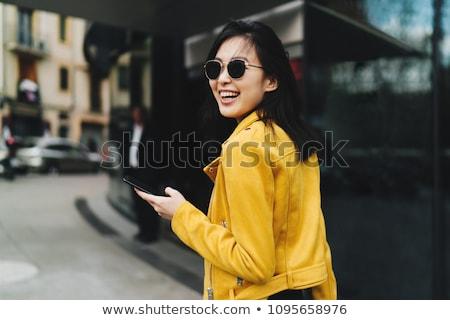 Fotografia uśmiechnięty asian kobieta długo ciemne włosy Zdjęcia stock © deandrobot