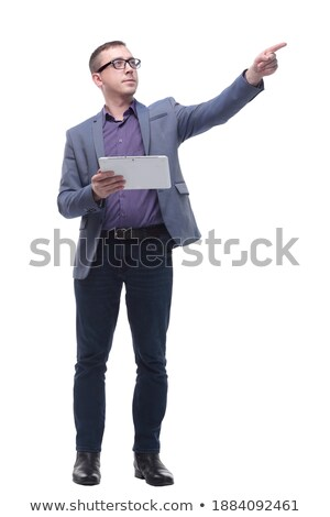 curious businessman with tablet looks and points to side stock photo © feedough