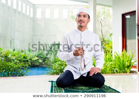 moslem men sit and pray Stock photo © superzizie