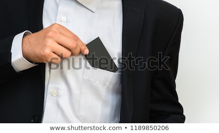 Businessman taking a greeting card out of his pocket Stock photo © Minervastock