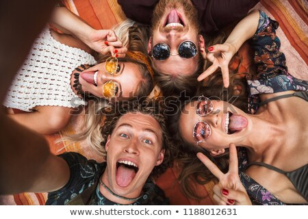 Portrait of lovely hippies friends guys and girls laughing, and  Stock photo © deandrobot
