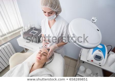 Beauty woman giving medical injections stock photo © ruslanshramko
