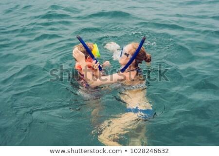 happy mother and son snorkeling at the ship Stock photo © galitskaya