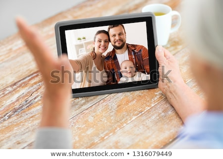 Kıdemli kadın video sohbet teknoloji Stok fotoğraf © dolgachov