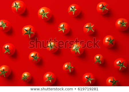 Tomatoes on a red background Stock photo © ConceptCafe