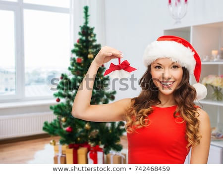 woman in santa hat with jingle bells on christmas Stock photo © dolgachov