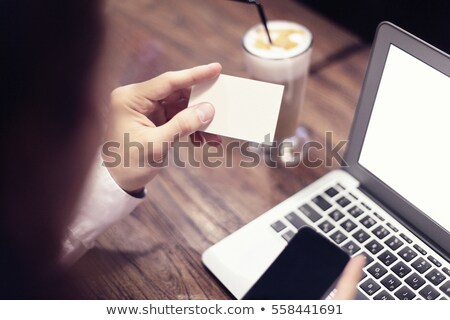 Close-up of man hands holding business card, working on laptop a Stock photo © Freedomz