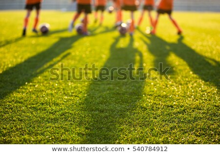 Elmosódott futballpálya iskola fiatal futball játékosok Stock fotó © matimix