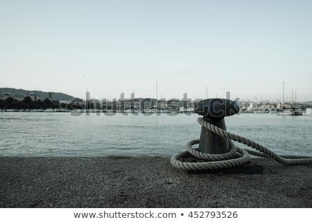 Sea ropes on the pier. Equipment for tying yachts concept Stock photo © galitskaya