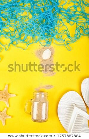 Notebook conchiglie vetro sabbia bianco top Foto d'archivio © Illia