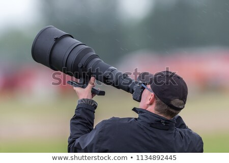 Photographer with big lens Stock photo © nomadsoul1