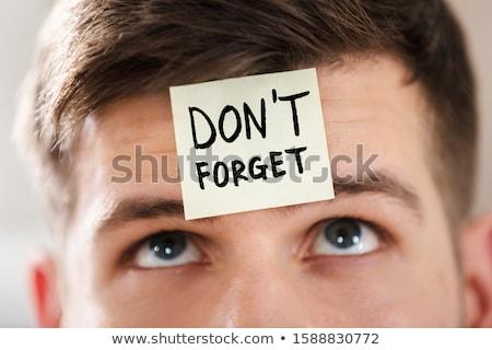 Note collante texte coincé front jeunes affaires Photo stock © AndreyPopov