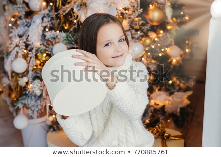 Blue eyed pretty lovely small child holds present box, wonders w Stock photo © vkstudio