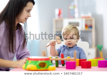mother and baby playing with toy blocks at home Stock photo © dolgachov
