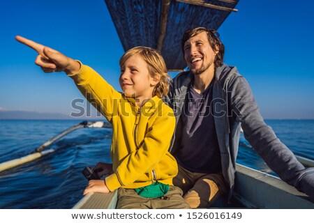 父から息子 夜明け 海 ボート 水 笑顔 ストックフォト © galitskaya