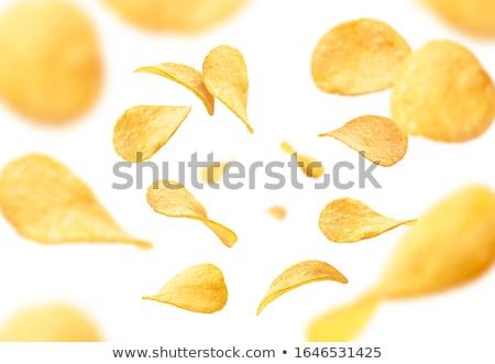 Chips witte achtergrond vliegen reclame Geel Stockfoto © butenkow