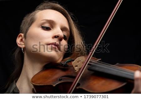 Portré dedikált profi nő hegedűművész játszik Stock fotó © Giulio_Fornasar