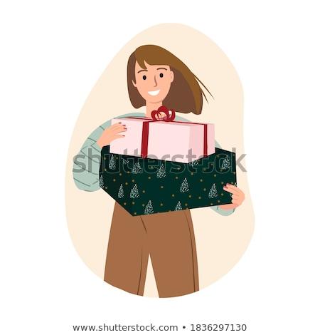 Girl holding christmas present stock photo © fahrner